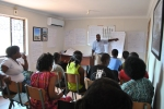 Livingstone training the first set of trainees on the business start-up course.