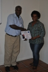 Snow receiving his certificate for completing the train the trainer workshop.