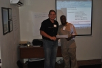 Hardus receiving his certificate for completing the train the trainer workshop.